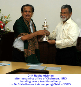 Dr K Radhakrishnan handing over Traditional Lamp to Dr. G Madhavan Nair, Out going Chief of ISRO
