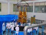 Spacecraft is being loaded into thermal vacuum chamber for environmental qualification test