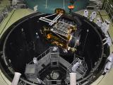 Loading Spacecraft for Thermovacuum Test in Large Space Simulation Chamber