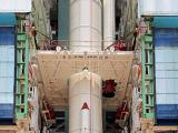 One of the strap-ons of PSLV-C25 being lowered to its position during vehicle integration