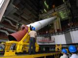 Unloading a PSLV-C11 strap-on from transporter at Vehicle Assembly Building