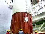 Placement of nozzel end segment of PSLV-C42 first stage over the launch pedestal