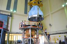 PSLV-C25 fourth stage being hoisted during its integration with the third stage