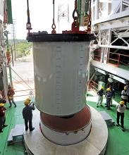 Two segments of PSLV-C25 First Stage being joined in Mobile Service Tower