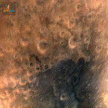 Mars Orbiter Spacecraft captures its first image of Mars. Taken from a height of 7300 km.